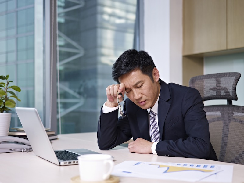 """""""asian businessman sitting in office, looking tired. click for more: abusiness peopleai"""""""